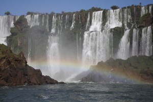 Dazzling rainbows provide a colourful foreground; Iguazu Falls, Argentina