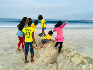 Frolicking in the sand with the favela kids, Rio de Janeiro, Brazil