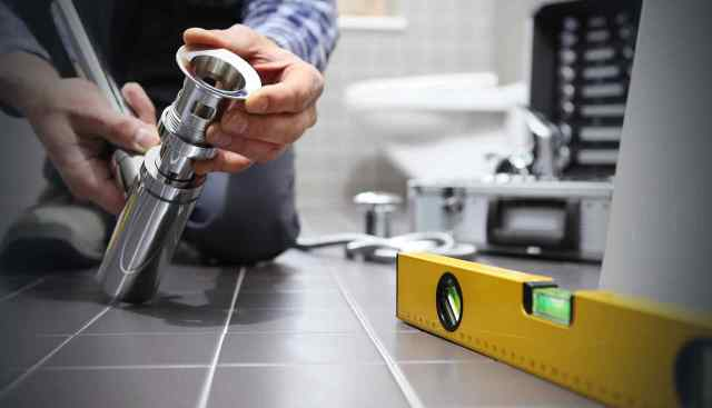 plumber in bathroom background