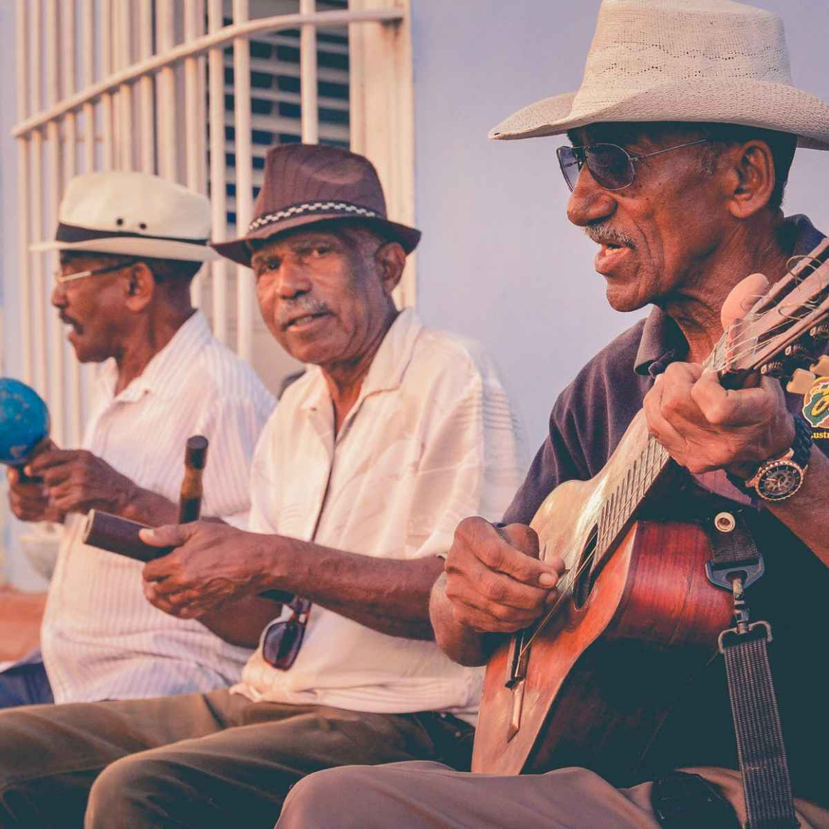 three men playing musical instruments