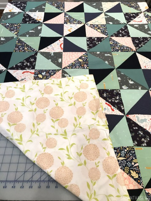 navy and mint triangle baby quilt