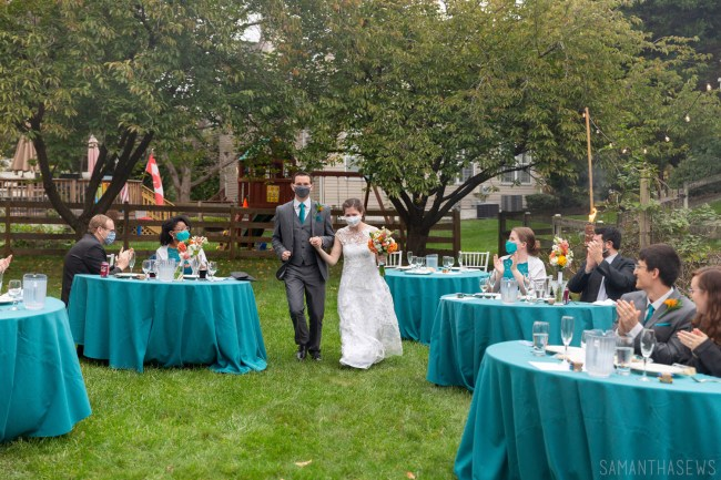 bride and groom wearing masks - DIY backyard wedding COVID-19