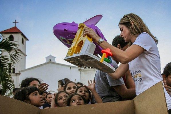 Salissa unloads toys to waiting girls