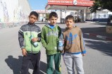 Ahmad and his friends hang out during their day-off school without caring about the Israeli forces who were threatening and shouting at them from the military tower.