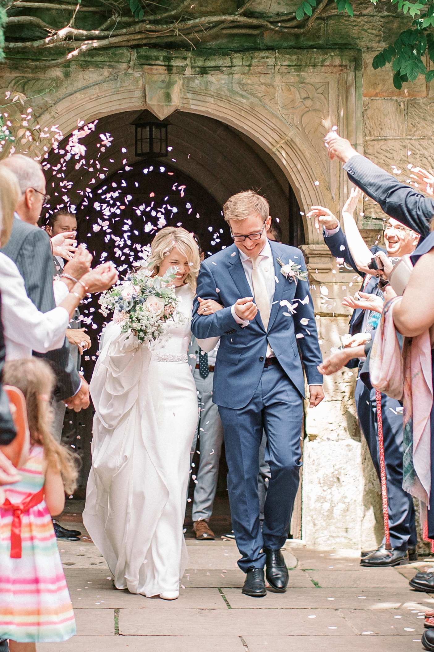 Couple exiting church after their wedding at Chiddingstone Castle