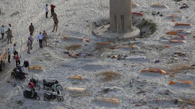 Indian police find bodies on riverbank amid raging COVID-19