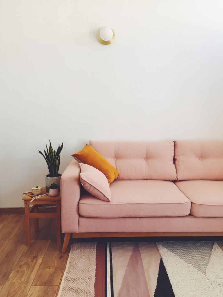 Our Paris home living room with pink couch