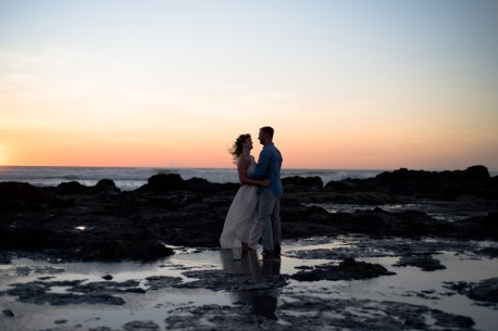Bride and groom at sunset in Tamarindo, Costa Rica. Photographed by Kristen M. Brown, Samba to the Sea Photography.