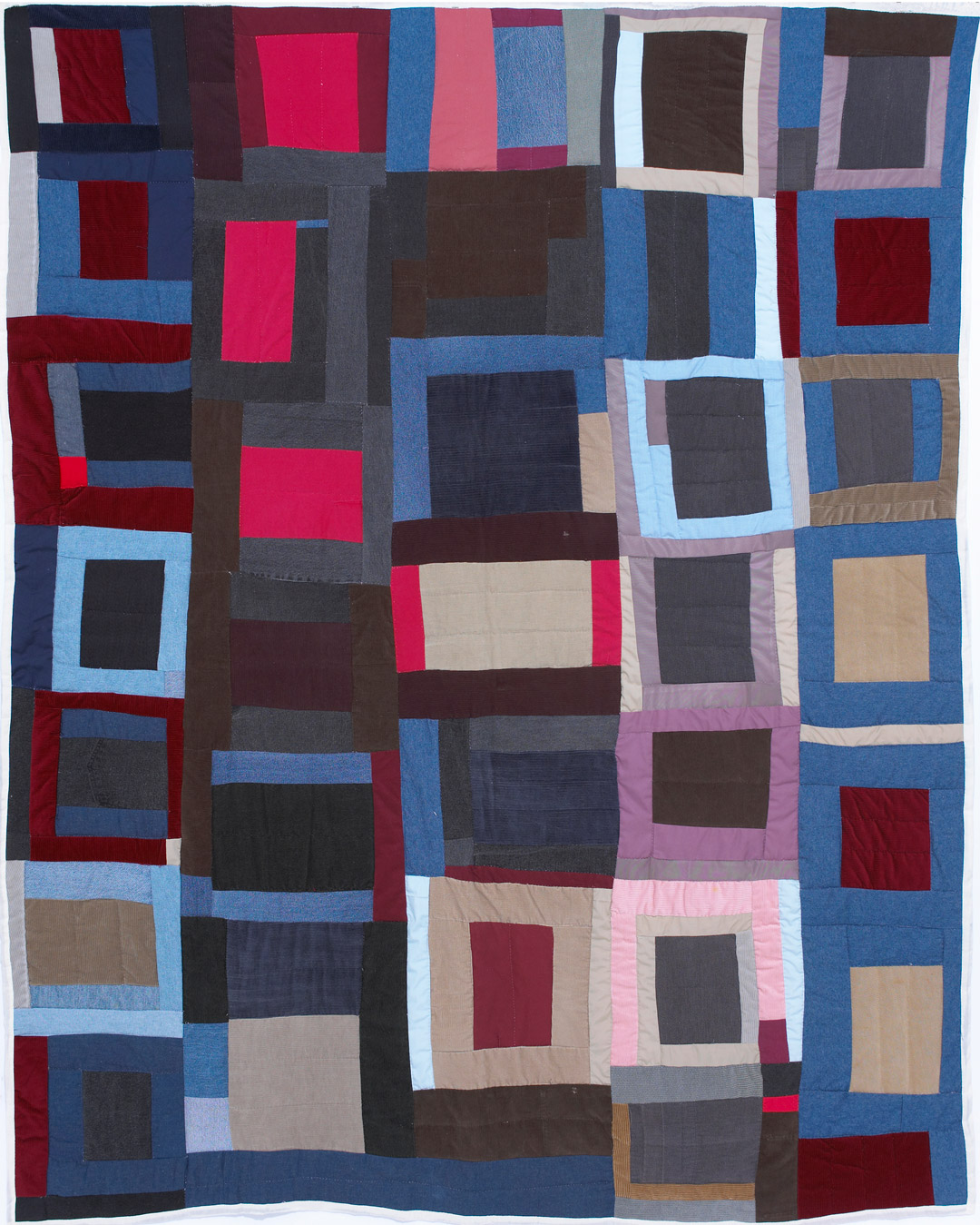 Image of a colorful quilt composed of blocks with repetition and rhythm