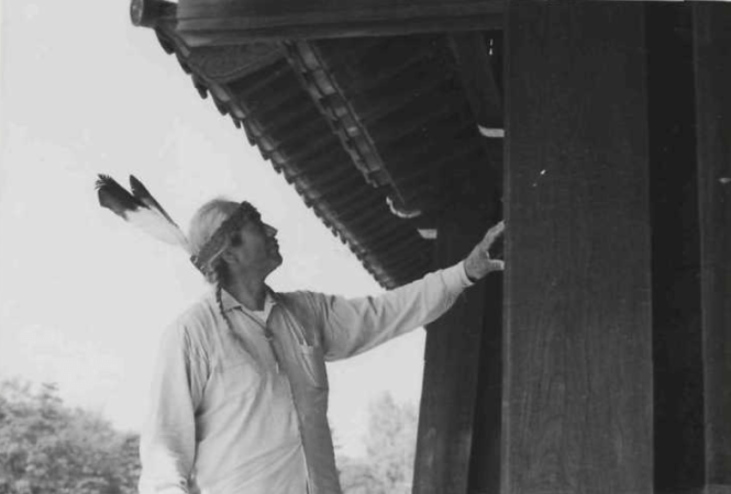 Joseph Hillaire stands next to pillar in Kobe, Japan. Image courtesy of The Seattle Public Library.