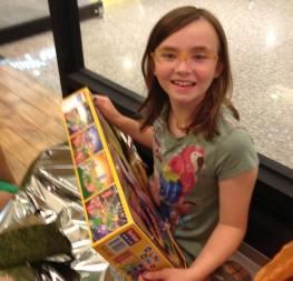 Katrine has wanted a domino set for ages - I think her smile says it all.