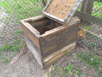 Compost bin with open lid