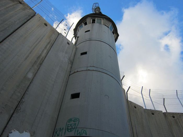 """The Open Air Prison"": Watchtower and apartheid wall, Bethlehem, Palestine."