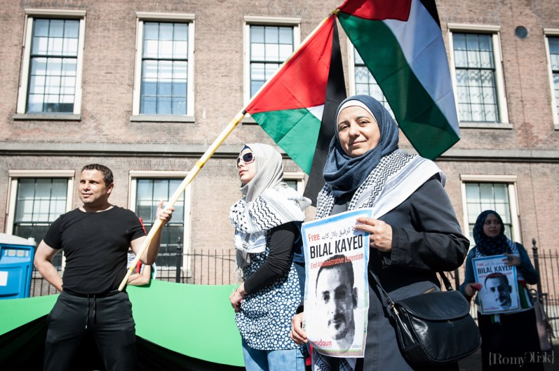 The Hague, The Netherlands. 24th June, 2016. 60 Palestinian prisoners in Megiddo prison are carrying out a hunger strike protest to demand freedom for Bilal Kayed, Palestinian prisoner held under Israeli administrative detention and on hunger strike in Ramon prison. Over 100 international and Palestinian organizations have called for actions in support of Kayed's freedom on 24 and 25 June; hundreds of prisoners will be conducting a two-day hunger strike protest on those days. Also they said that the Dutch state pension for illegal settlers goes against international and Dutch law. They demand an end to the support for the colonization and occupation of Palestine. The protest began around the Central Station and walked to the Drees-monument that is close to the Israeli embassy. © Romy Arroyo Fernandez/Alamy Live News.