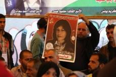 Demonstrator holds a photo of Khalida Jarrar