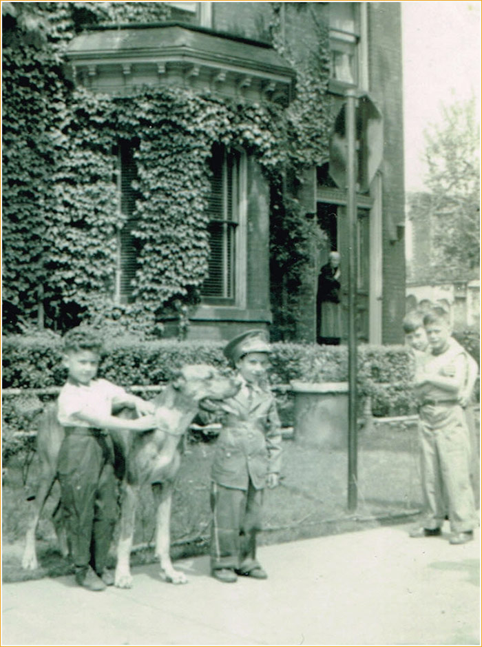 Photograph: Joe Scime, Eric the Great Dane and Vince Agro in front of the colonia House. Grace's Mother is standing on the front stoop.