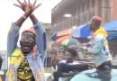 Video: Shatta Wale sprays cash on the street of Kumasi as crowd mobs him