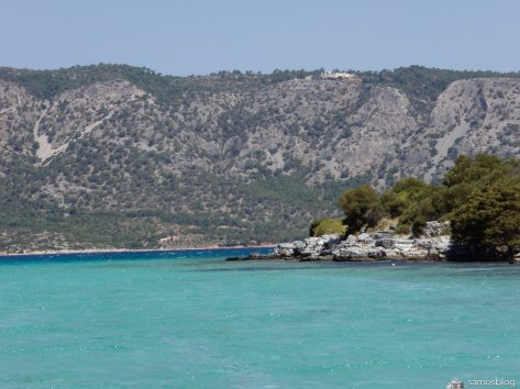 Turquoise water with Moni Zoodochos Pigi in the background