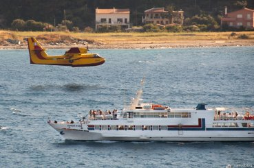 Firebomber in Samos bay giving tour boat guests an experience