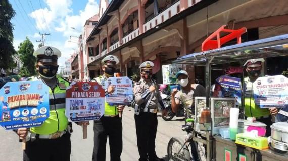 Sat Lantas Polres Kotim Laksanakan Himbauan Tertib Berlalu Lintas dan Sosialisasi Prokes