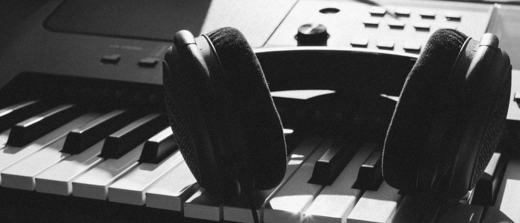 Not obscure but still public domain - headphones on a keyboard