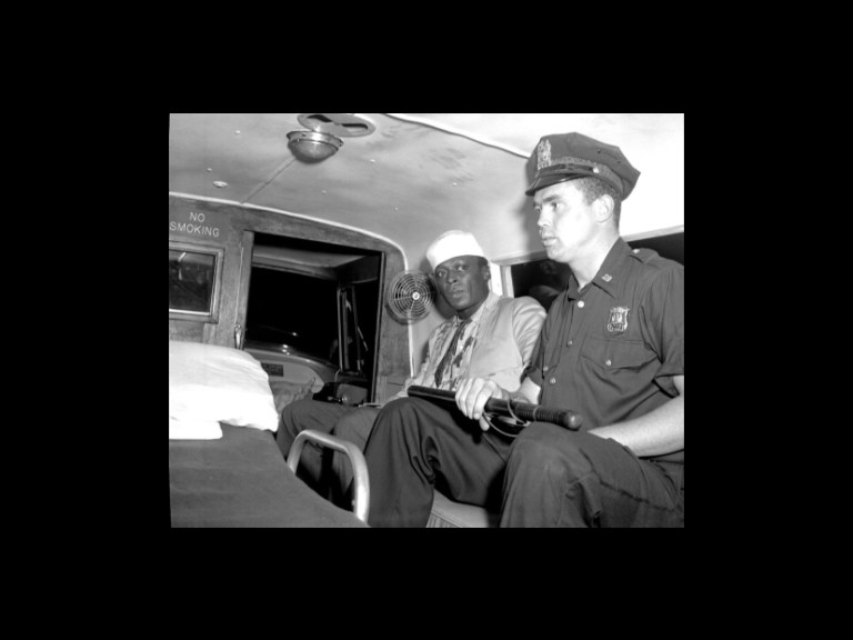 Miles Davis in a police van after being arrested and beaten
