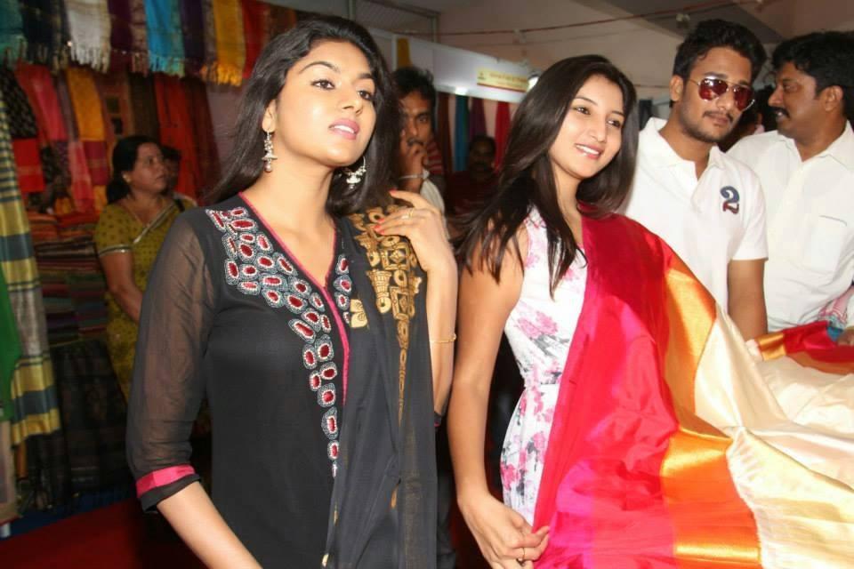 Actress Vinny & co-stars selecting dress material at Samprada.