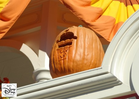 Pumpkins line Main Street USA, with special carving based on the store below.