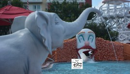 An Elephant Baths with the kiester coaster clown in the background