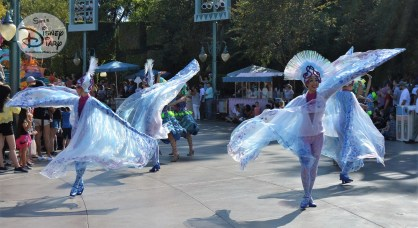 Sebastian's Calypso Carnival Parade Unit Follows Aladdin