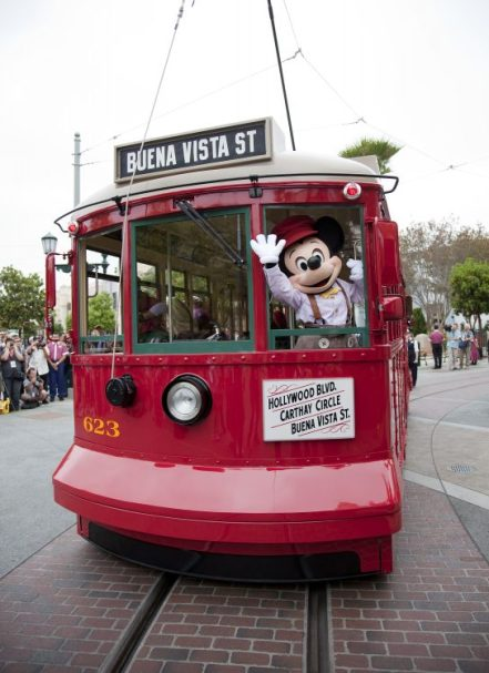 Mickey Mouse waves while riding the Red Car Trolley during the Red Car News Boys show at Disney California Adventure park at Disneyland Resort in Anaheim, Calif. (Paul Hiffmeyer/Disneyland Resort)