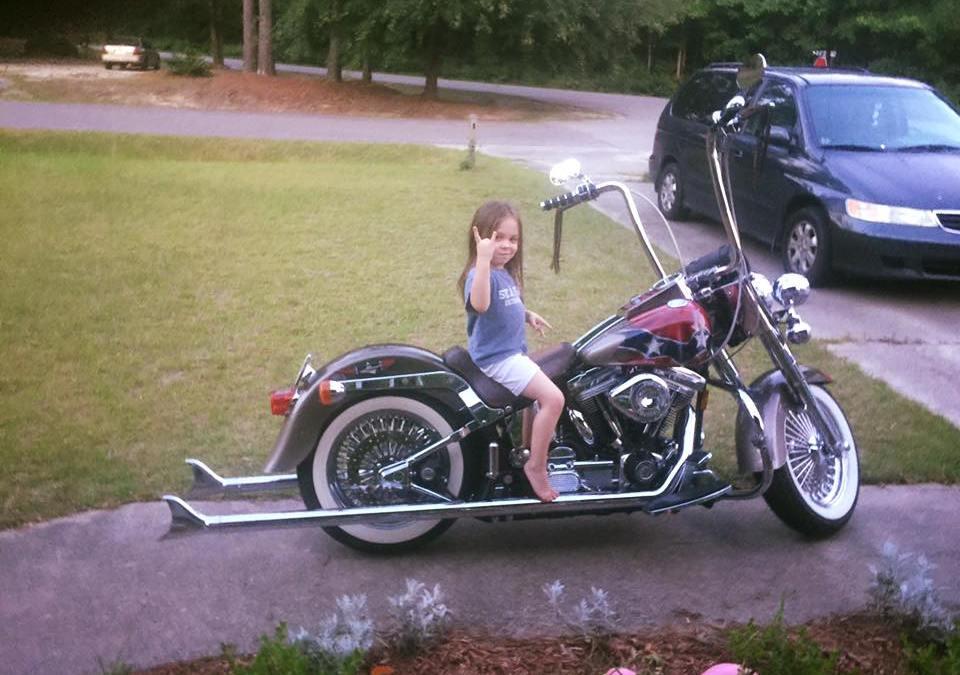 John Aaron's Little Miss has Assumed Control of his Bike