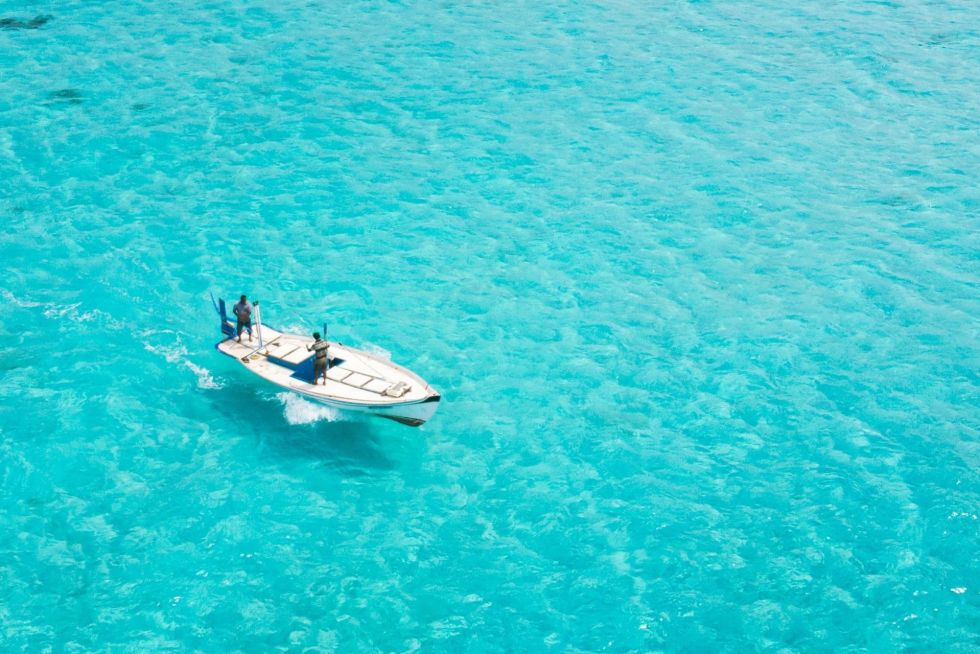 Dhoni (Traditional Maldivian Boat) Sailing on Turquoise Blue Waters
