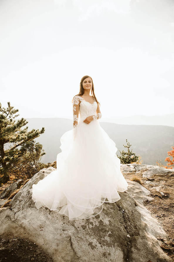 bride at table rock during sunset