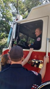 Captain Brian Santos drives a new structure fire engine during the 2017 Independence Day Parade in Mokelumne Hill.