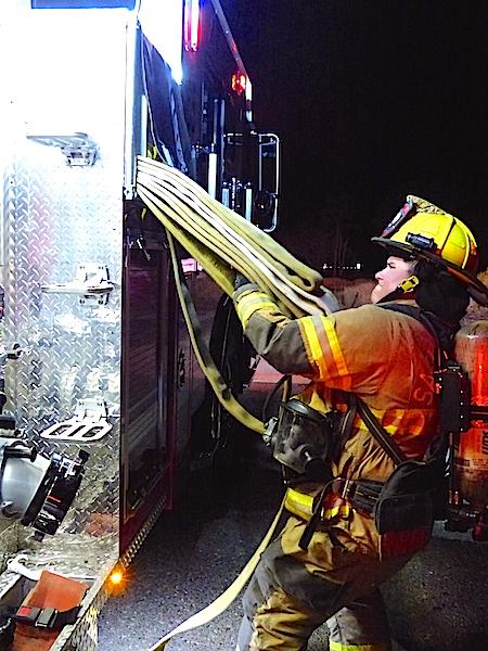 Firefighter Caleb Steffes pulling hose.