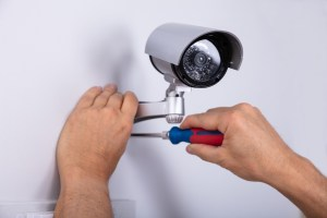 Technician Fixing Security Camera