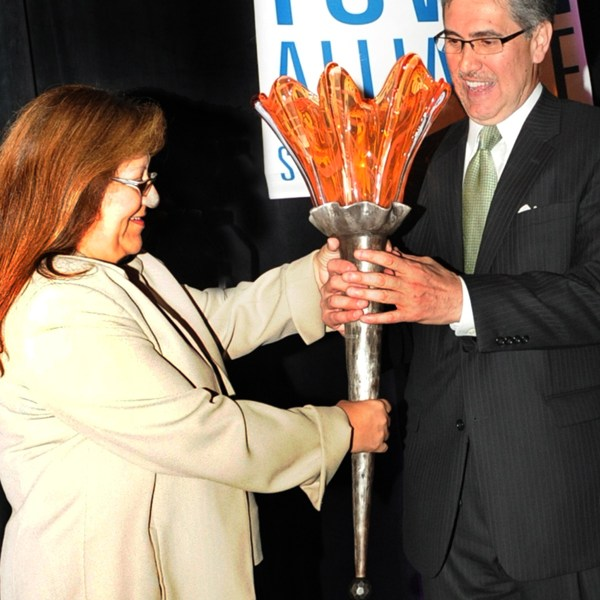 Pat DiGiovanni accepts the Downtowner of the Year Torch