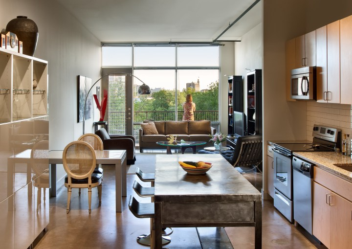 Interiors are modern with concrete floors softened by large windows that let in ample light.