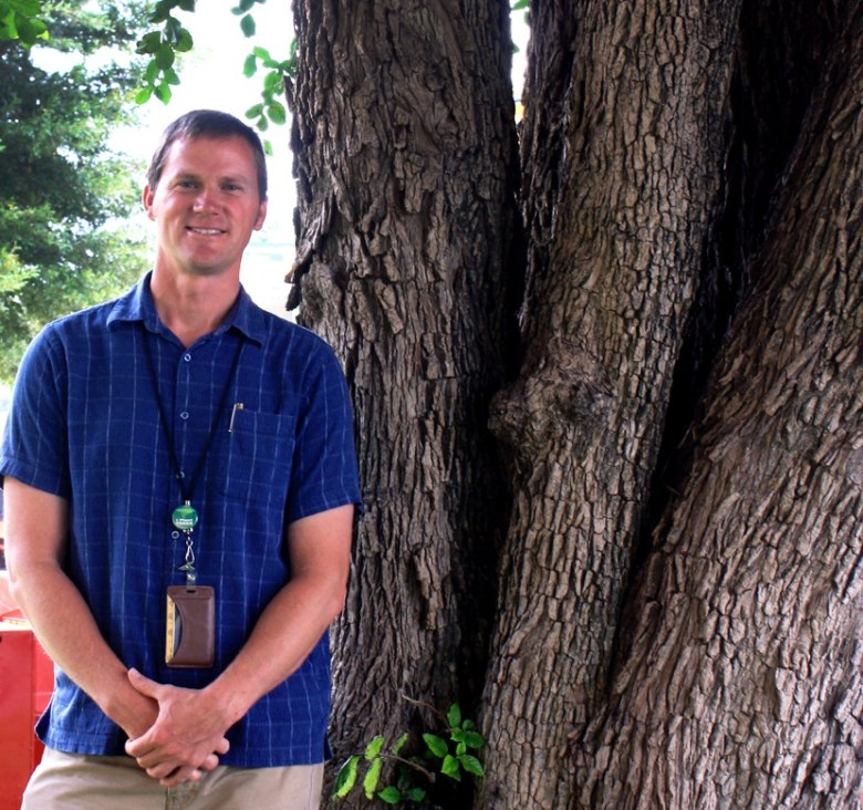 Michael Nentwich, San Antonio City Forester, with his favorite tree, an Anaqua at the Bexar County Courthouse