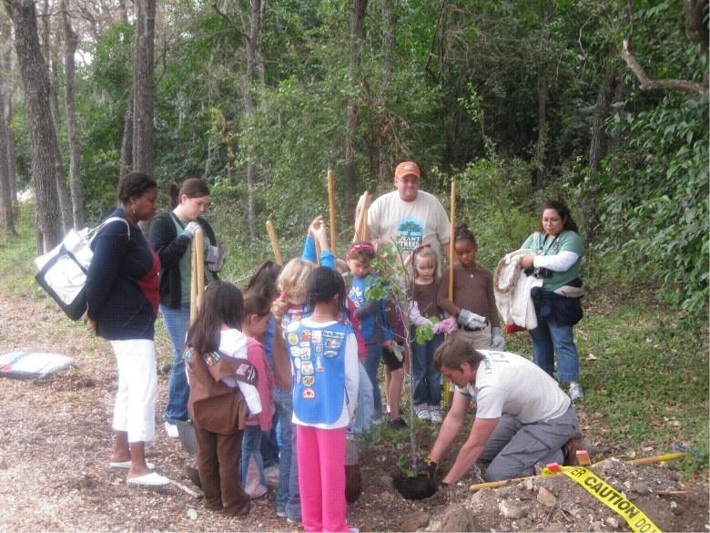 City of San Antonio Forester Michael Nentwich demonstrates proper tree planting technique.