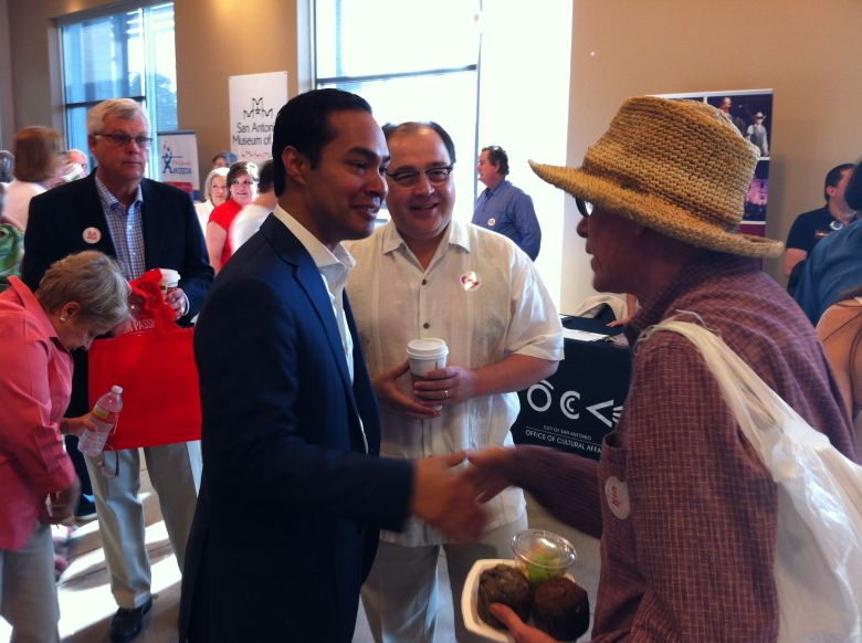 San Antonio Mayor Julián Castro greets a citizen at the TriPoint YMCA before addressing the crowd.