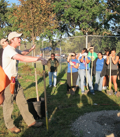 City Forester Michael Nentwich demonstrates proper tree planting technique to OLU Students at Rosedale Park, photo courtesy San Antonio Parks and Recreation