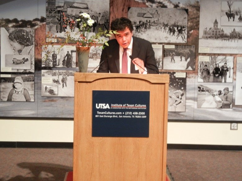 Hernandez at an award ceremony for an essay competition at UTSA.