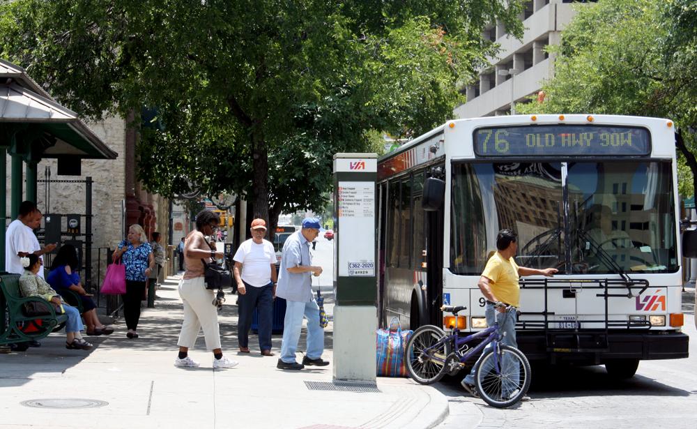 Passengers board a VIA bus in downtown San Antonio. Photo by Iris Dimmick.