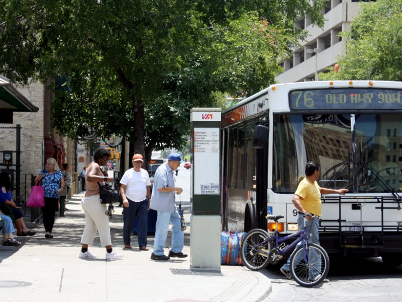 Passengers board a VIA bus in downtown San Antonio. Photo by Iris Dimmick.