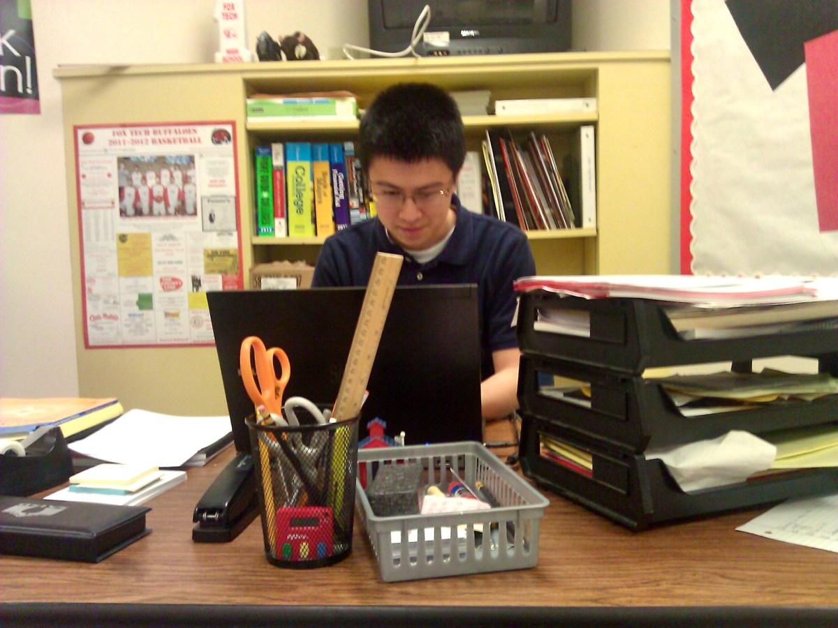 Chan sits on his teacher desk at Fox Tech.
