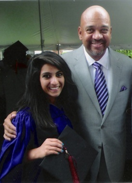 Dhalia with ESPN reporter Michael Wilborn after graduation ceremonies at Northwestern University in June.