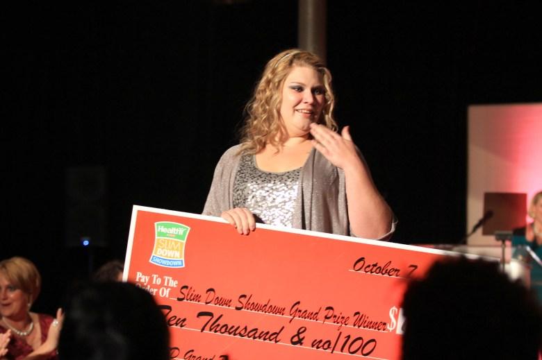 Alison Spangler receives her winnings.
