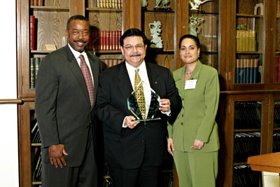 Lewis Legacy Award for Distinguished Service in Urban Affairs: Walter Huntley and Jelynne Burley present prize to Alex Briseno, '71, '73